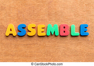 assemble colorful word on the wooden background