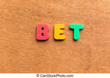 bet colorful word on the wooden background