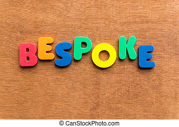 bespoke colorful word on the wooden background