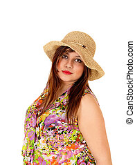 Serious girl with straw hat - A portrait shot of a serious...