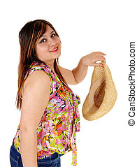 Woman holding her straw hat.