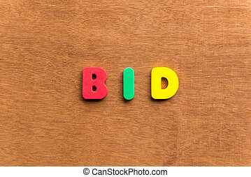 bid colorful word on the wooden background