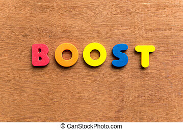 boost colorful word on the wooden background