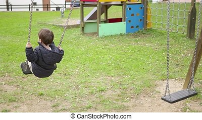 Baby Toddler Swinging on the Swing - Child playing in the...