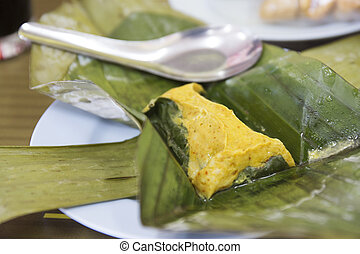Steamed fish curry cake in banana leaf