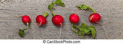 Radishes - Fresh radishes on old wooden background Panoramic...