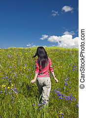 girl - the girl walking outdoor of the meadow