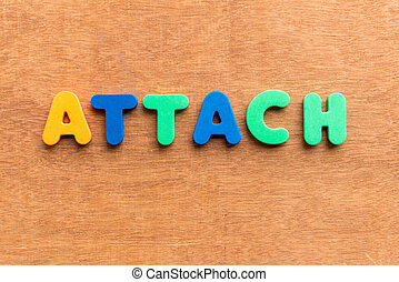 attach colorful word on the wooden background