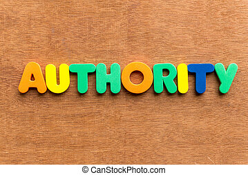 authority colorful word on the wooden background