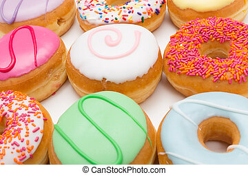 everywhere donuts - a large amount of donuts in front of...