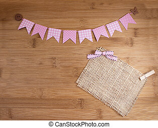 Bunting banners - Pink bunting banners on wooden background.