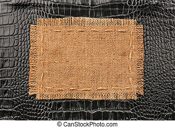 Frame of burlap, lies on a background of black leather, with...