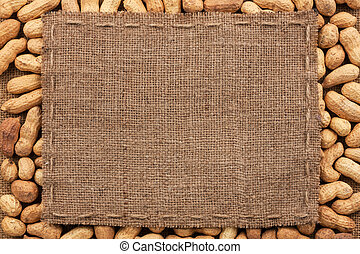 Frame made of burlap with the line lies on peanut, with...