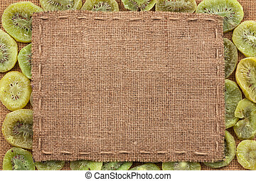 Frame made of burlap with the line lies on kiwi, with place...