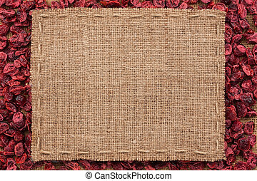 Frame made of burlap with the line lies on cranberry, with...