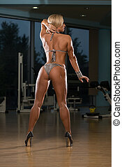 Woman In High Heels Showing Her Trained Body