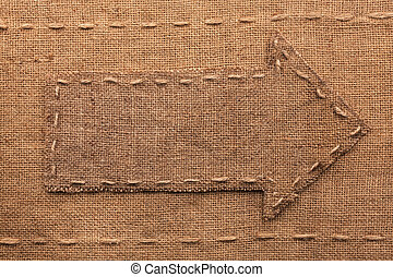 Pointer made of burlap, lying on sackcloth, with place for...