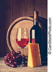 Bottle and glass of red wine with cheese