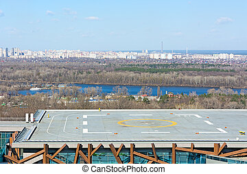 Helipad. - Helipad on the roof of the building on the city...