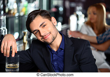 Young man in the bar - Looking for the new acquaintance...