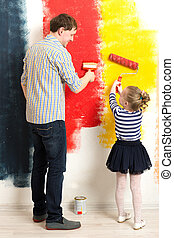 Father and daughter painting wall - Father and little...