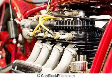 Detail of engine - Closeup view of old red motorcycle engine