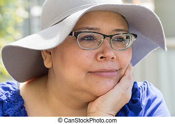 Cancer Patient Wears Hat For Sun Protection - Female woman...