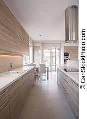 Wooden kitchen unit in bright luxury interior