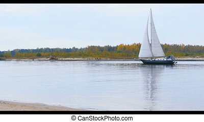 Sailing yacht sailing in the river - Sailing yacht catamaran...