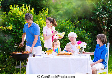 Big happy family enjoying bbq grill in the garden - Grill...