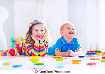 Cjildren playing with wooden toys - Kids playing with wooden...