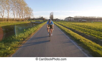 cyclist man cycling countryside - healthy man riding bike...
