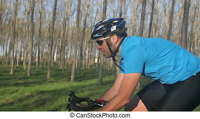 cyclist man rides bike close up - male riding bicycle...