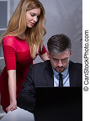 Secretary and boss - Young beautiful secretary talking with...