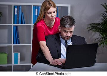 Beautiful boss and employee - Beautiful female boss helping...