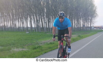 cyclist riding bycicle slow motion - man riding bicycle...