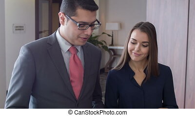 Young dark-haired beautiful smiling woman going talk with boss