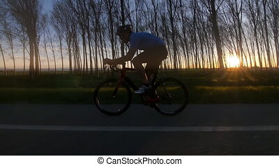 cyclist silhoutte rides bycicle - healthy man riding bike...