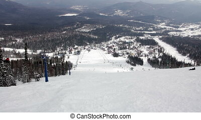 View of winter mountains and ski resort