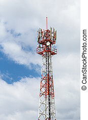 Communications tower with antennas against on sky