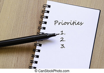 Priorities Concept White Notepad And Ink Pen On The Wooden...