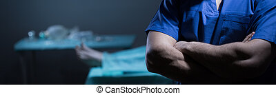 Surgeon standing with crossed arms - Surgeon guilty of...