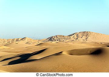 Dry Desert Sand Dunes - Arid desert sand dunes near...