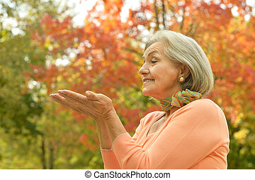 Happy old woman - Happy beautiful old woman in the autumn...