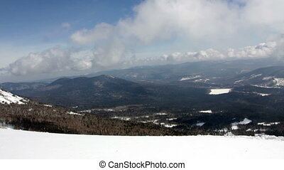 Picturesque view of snowy mountains in sunny day