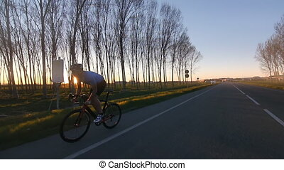 healthy man cyclist rides bycicle - cyclist riding bike...