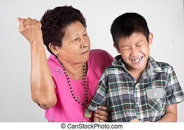 grandmother scolds her grandson.