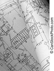 Monochrome view of old house plans unrolled
