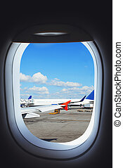 Airplane preparing to flight, view from aircraft window on...
