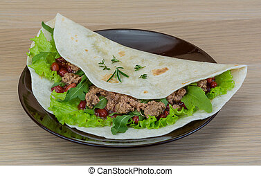 Burrito with tuna, ruccola and red beans
